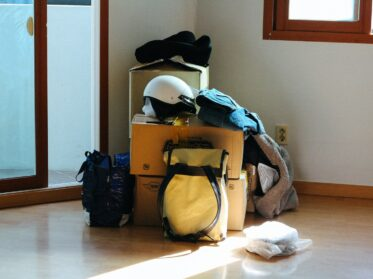 black and blue backpack on brown wooden table